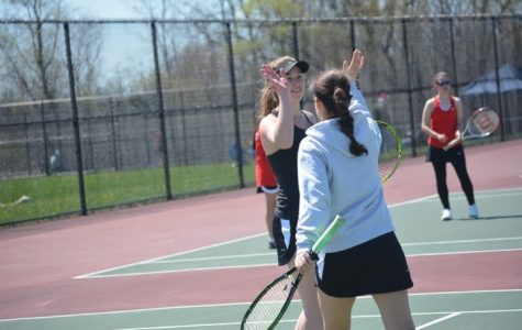 Although two doubles players Carly Demkowicz and freshman Jacqueline Hijaouy lost their match, they still managed to keep a positive attitude. (Photo credit: Roxana Hijaouy)