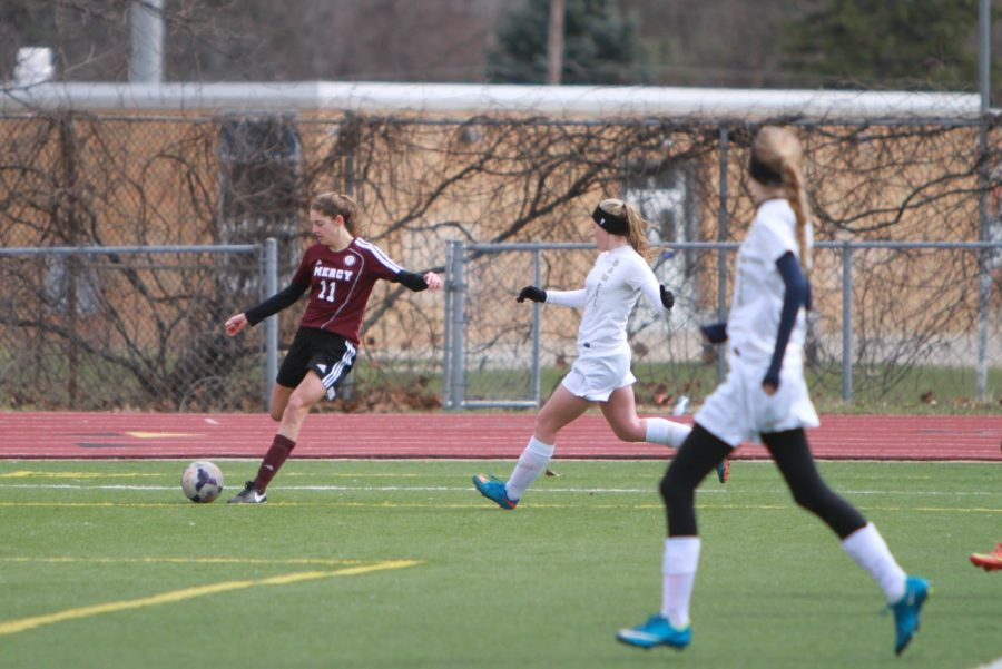 Freshman Chloe Woodbeck (#11) has made her mark on MVS as a starting midfielder. She often plays with her sister, senior Brianna Woodbeck, on the field, making them an unstoppable dynamic duo. (Photo credit: Andy Swiecki)