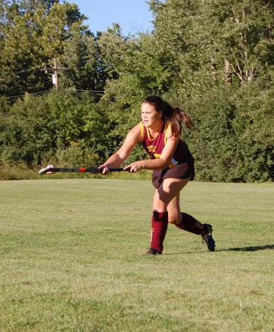 Zabrina LeVasseur warms up before an away game against Marian, in which she was a starting forward. (Photo Credit: Ana Warner)