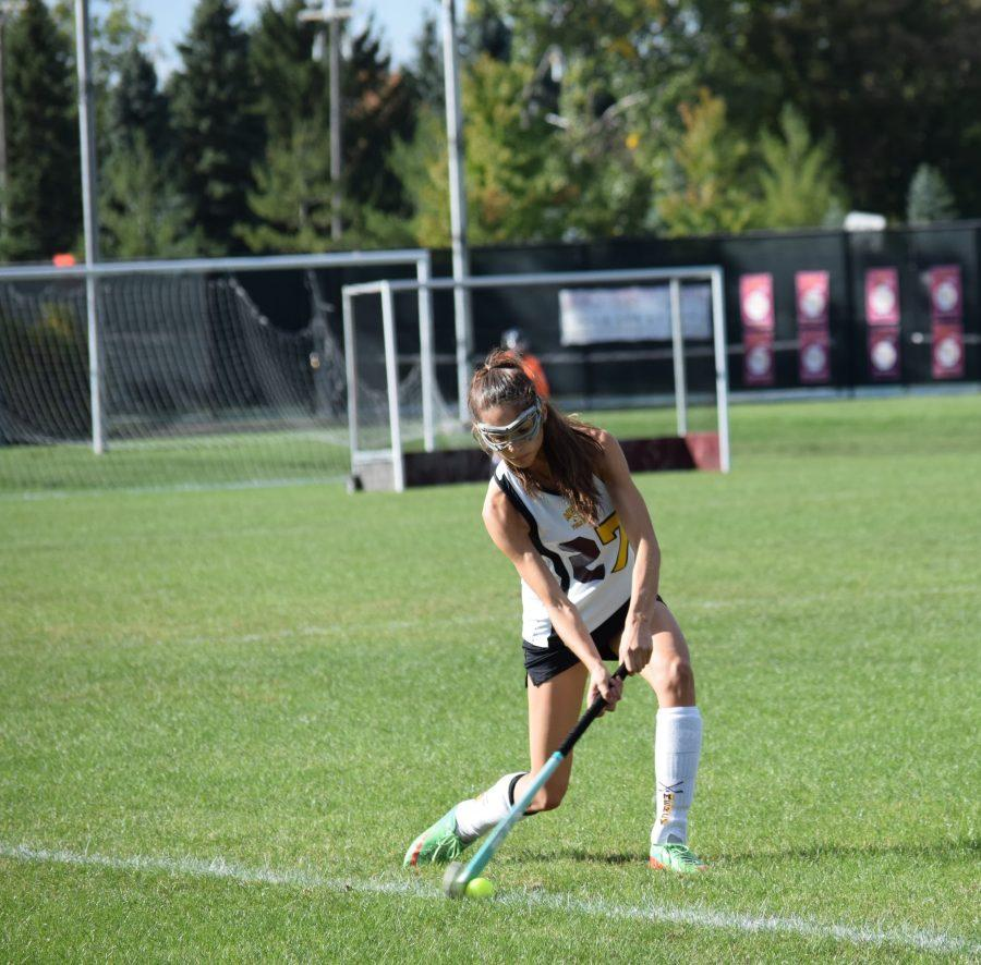 Junior Lexi Thomas hits a ball in from the sideline. (Photo Credit: Joanna Drukker)
