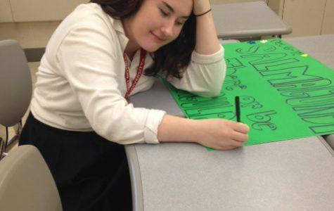 JCL officer senior Ellie Janitz creates a poster to promote Salmagundi. (Photo Credit: Katherine Colleran)