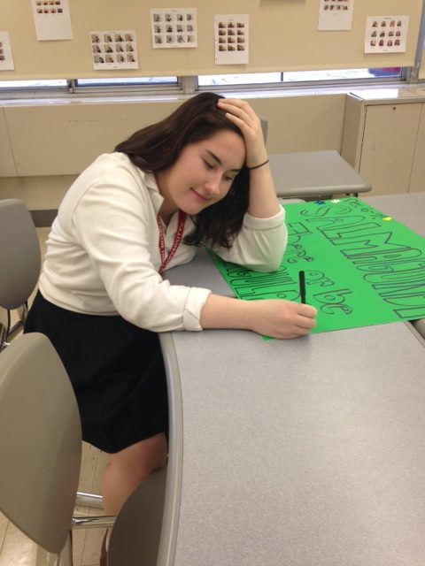 JCL officer senior Ellie Janitz creates a poster to promote Salmagundi. (Photo Credit: Katherine Colleran)