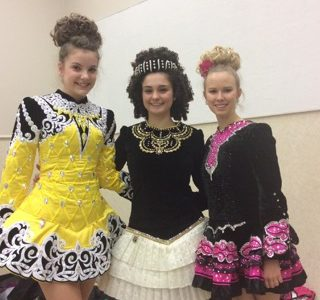 Mercy junior Kathryn Wolf poses with her fellow performers, junior Annie Acho Tartoni and freshman Bridget D'Amore, dressed in traditional Irish costumes.