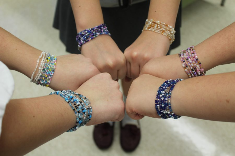 Juniors+Sarah+Kullen+and+Sydney+Price+sell+these+bracelets+at+various+prices+to+raise+money+to+help+communities+in+Sierra+Leone.+The+bracelets%2C+as+shown+above%2C+come+in+a+variety+of+colors+and+patterns.+%28Photo+Credit%3A+Libby+Miodonski%29