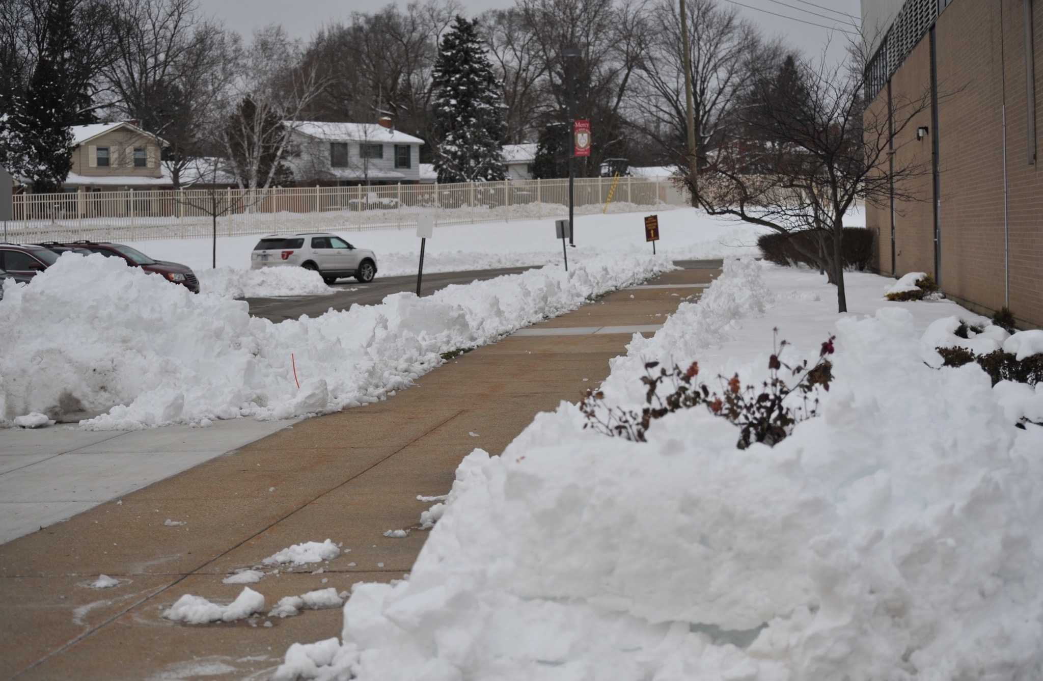 Snow was piled high outside Mercy High School after a recent snow day. (Photo Credit: Clarisa Russenberger)