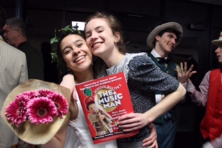 Seniors Claire Alafita and Ann Nelson embrace on opening night of U of D's performance of The Music Man. The musical was performed Thursday-Sunday, Feb. 23-26. (Photo Credit: Brooklyn Rue)