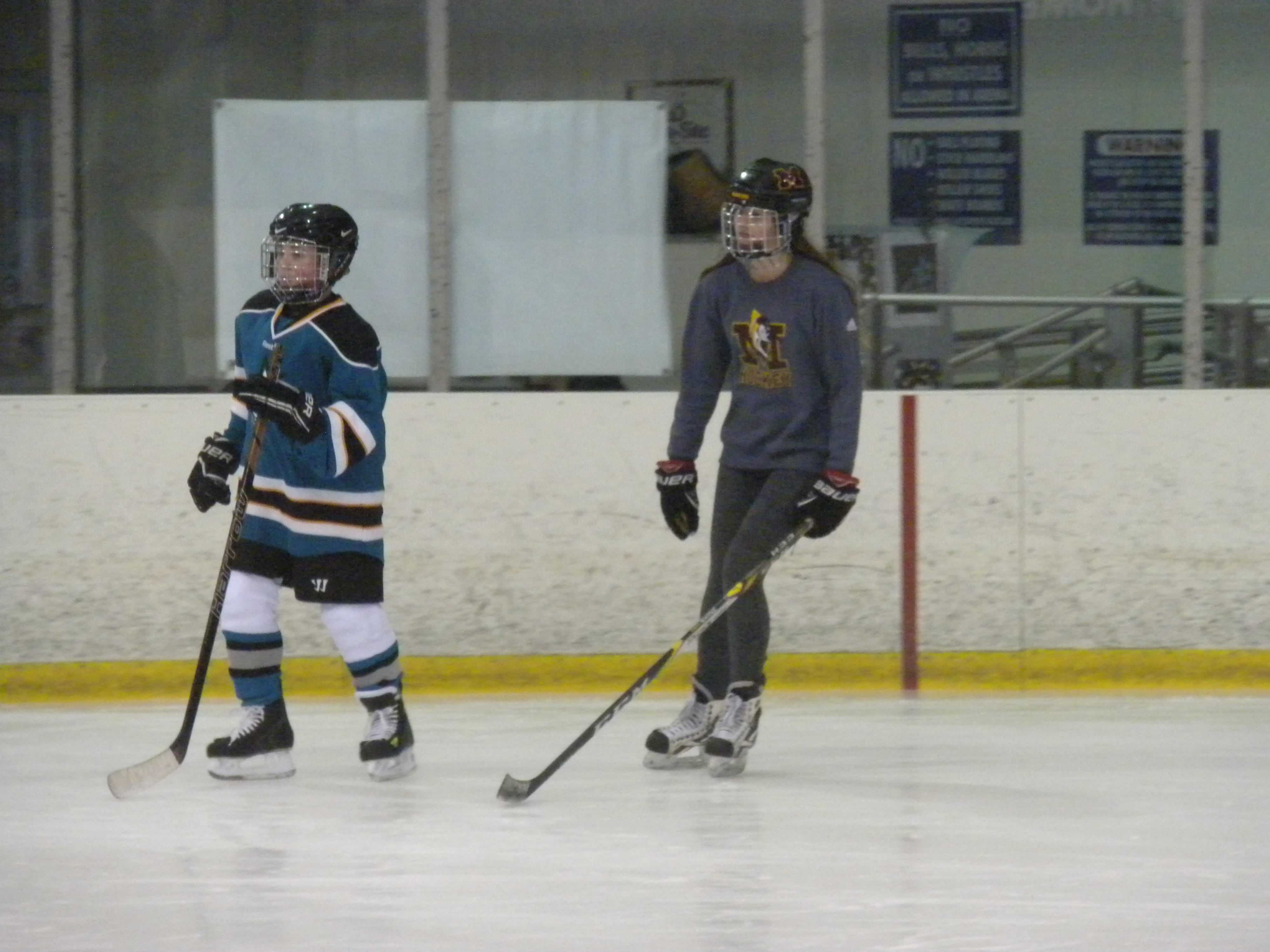 Junior Elena Ervin skates next to a MORC Star player during the learn-to-skate session. (Photo Credit: Shannon Seabolt)