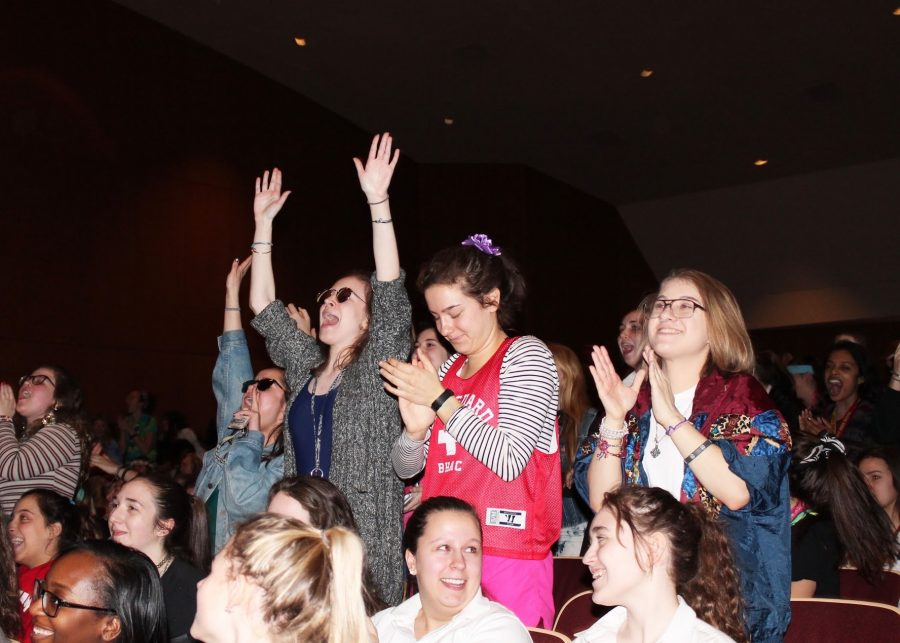 Seniors Cassie Roberts, Claire Johnston, Ann Nelson, and Claire Alafita enthusiastically cheer during the fashion show portion of the assembly.