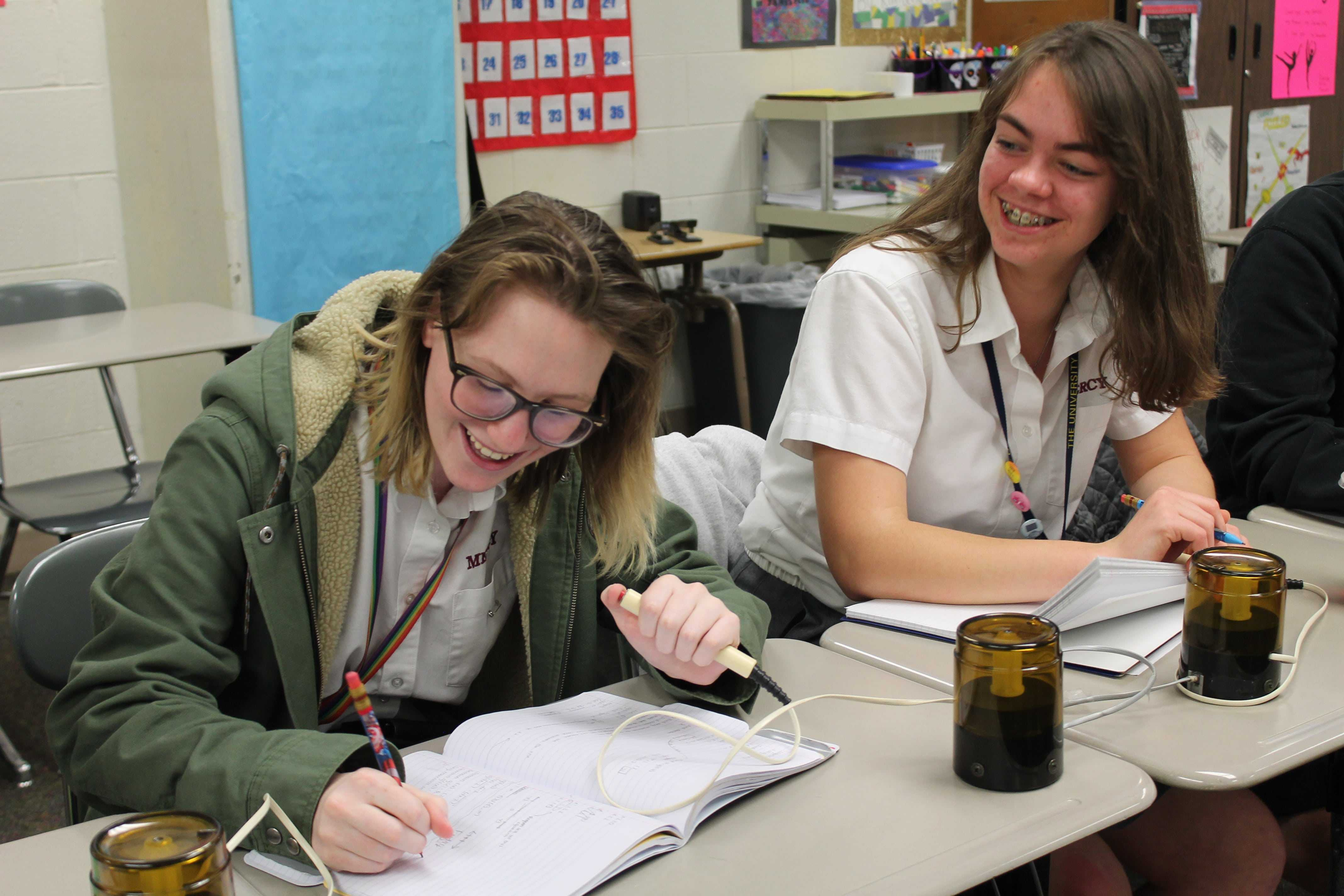 Senior Grace Salzeider uses her buzzer to signal that she has an answer to the question asked. (Photo Credit: Clarisa Russenberger)