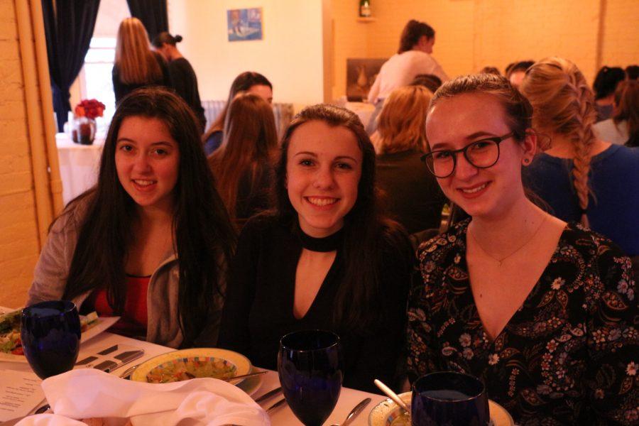 Juniors Caroline Weaver, Maggie Delevie, and Grace Drukker pose at their table. (Photo Credit: Karina Lloyd)