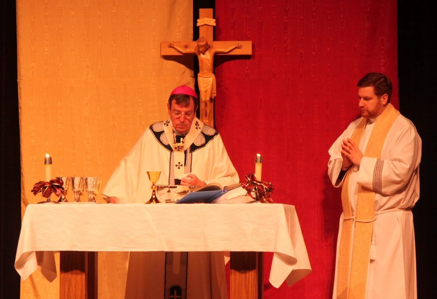 Archbishop Allen Vigneron said prayers over the Eucharistic gifts at Mass. (Photo Credit: Anastasia Warner)