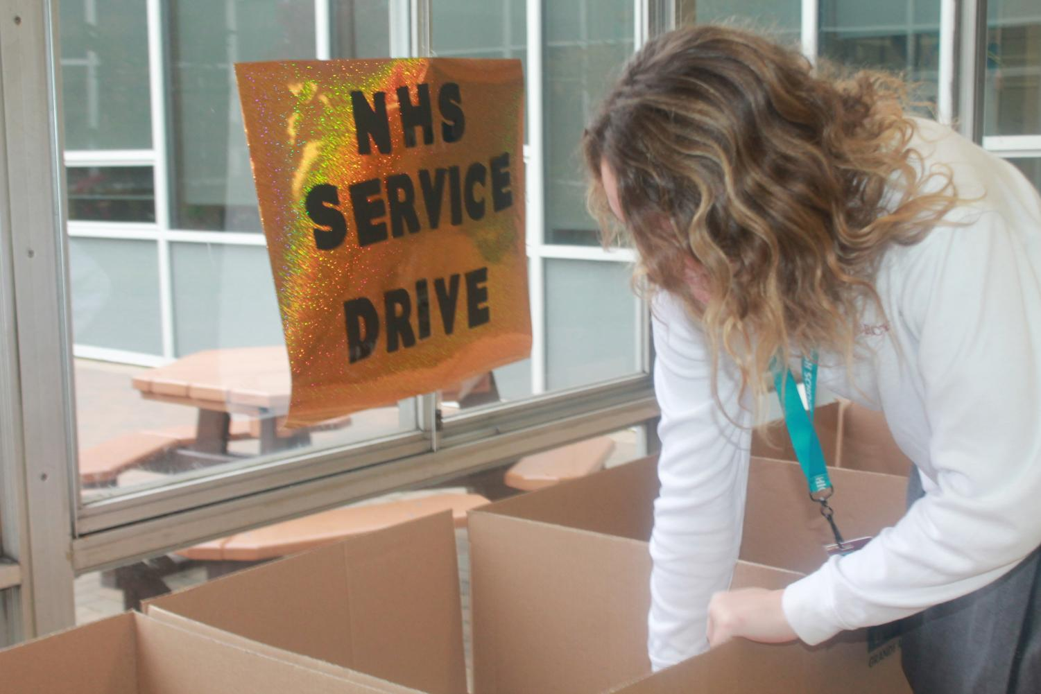 """Senior Emily Engler donates her clothing with a feeling of pride and fulfillment. """"It feels really good to help the people that need our support and our donations,"""" said Engler. (Photo Credit: Emma Tomsich)"""
