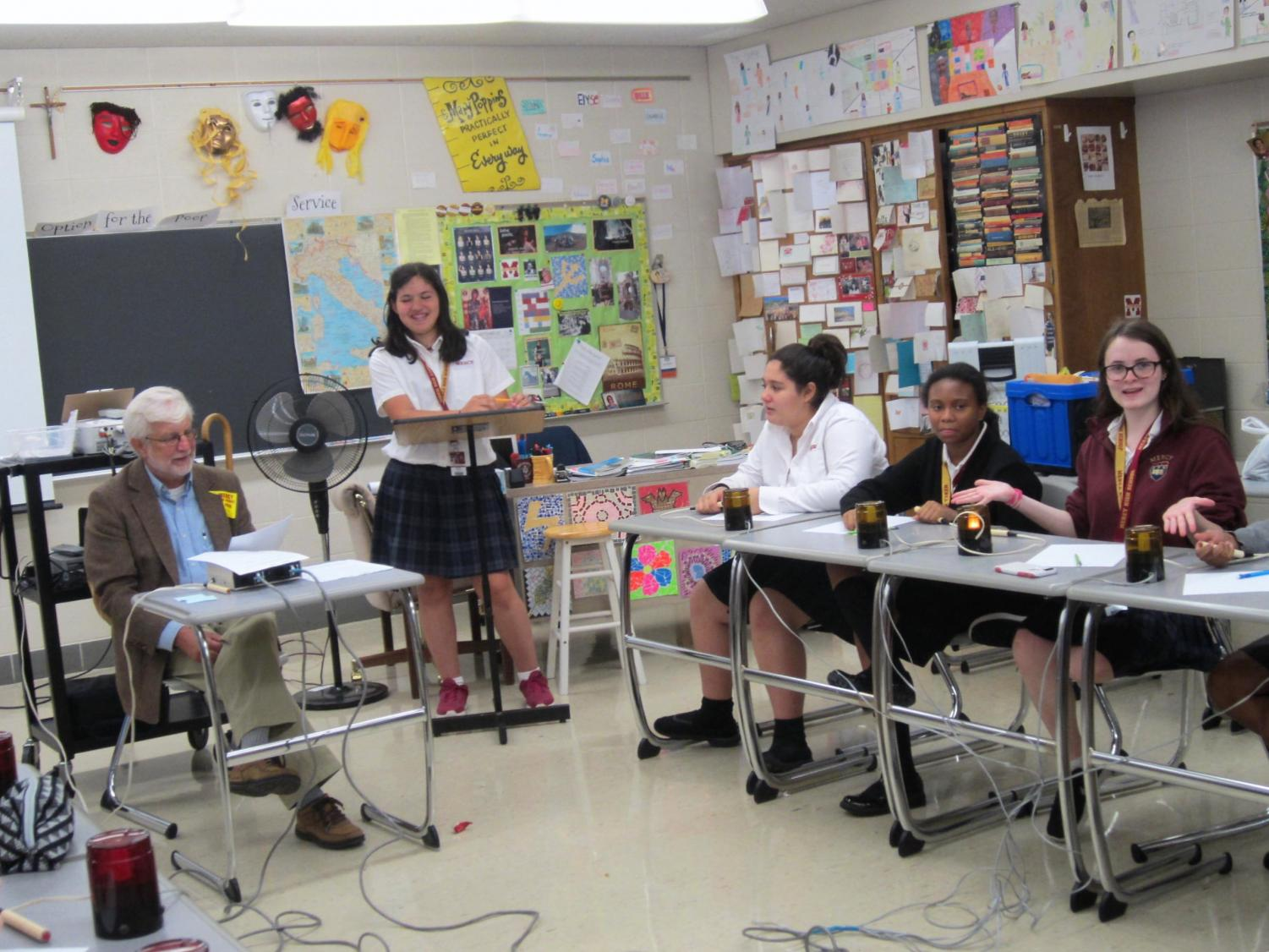 The quiz bowl team practices with Mr. Wolfe (photo used with permission from Mrs. Lusch)