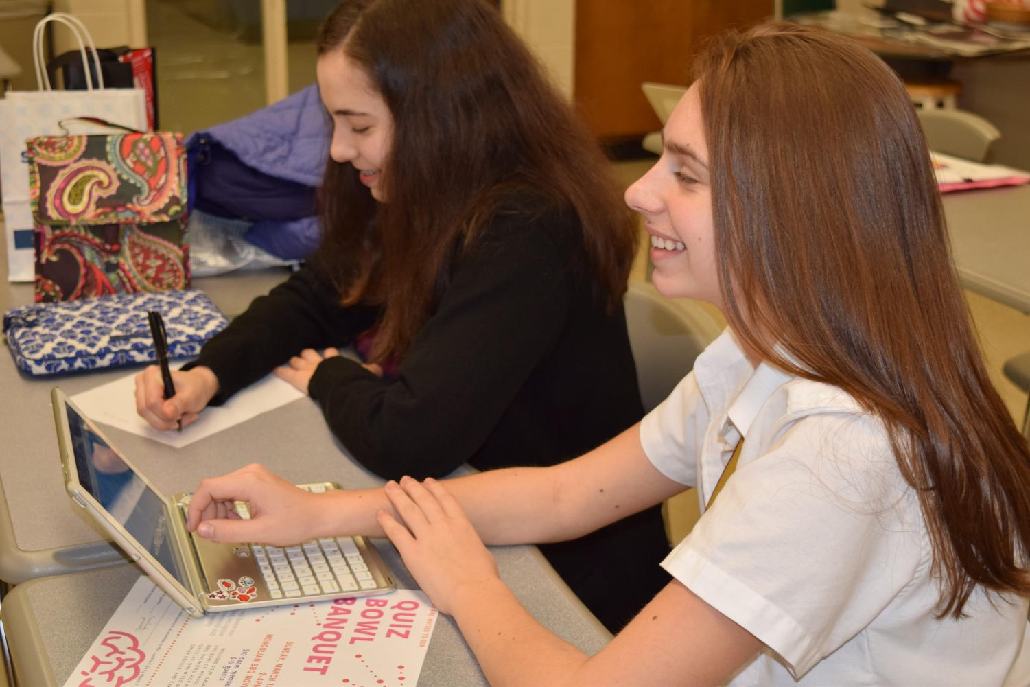 Members of Mercy's novice team participate in a Kahoot at one of Quiz Bowl's weekly Tuesday practices.