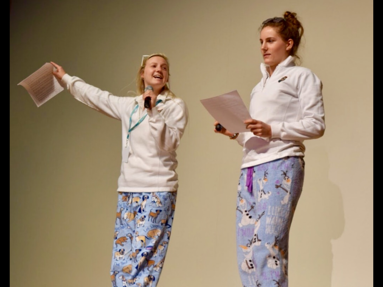 The Student Council president, senior Mary Doman, along with Sweepstakes committee member and senior officer Catie Coffman, encourage students to sell Sweepstakes tickets at the assembly after the conclusion of the MTV-themed video.