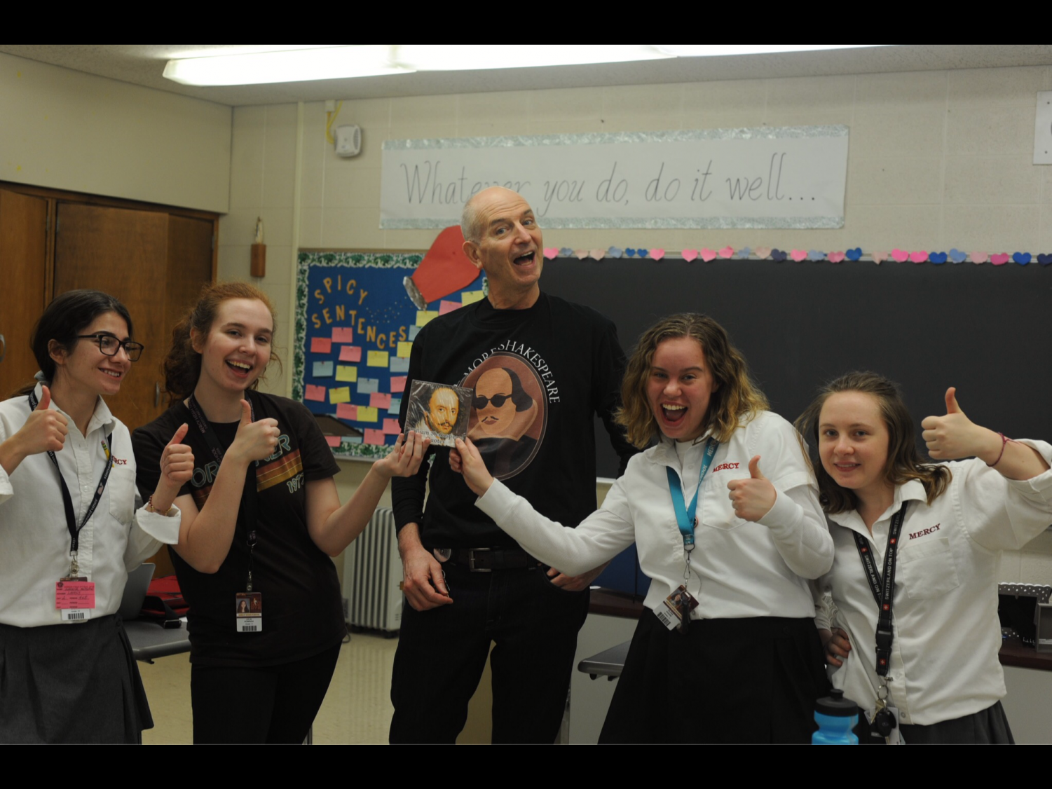The winning team from the Shakespeare-themed scavenger hunt pose with Mr. Larry Baker and their prize, a box of Shakespeare chocolates. Although the Shakespeare Society has only seven students this year, the group has plenty of fun. (Photo Credit: Anastasia Warner)