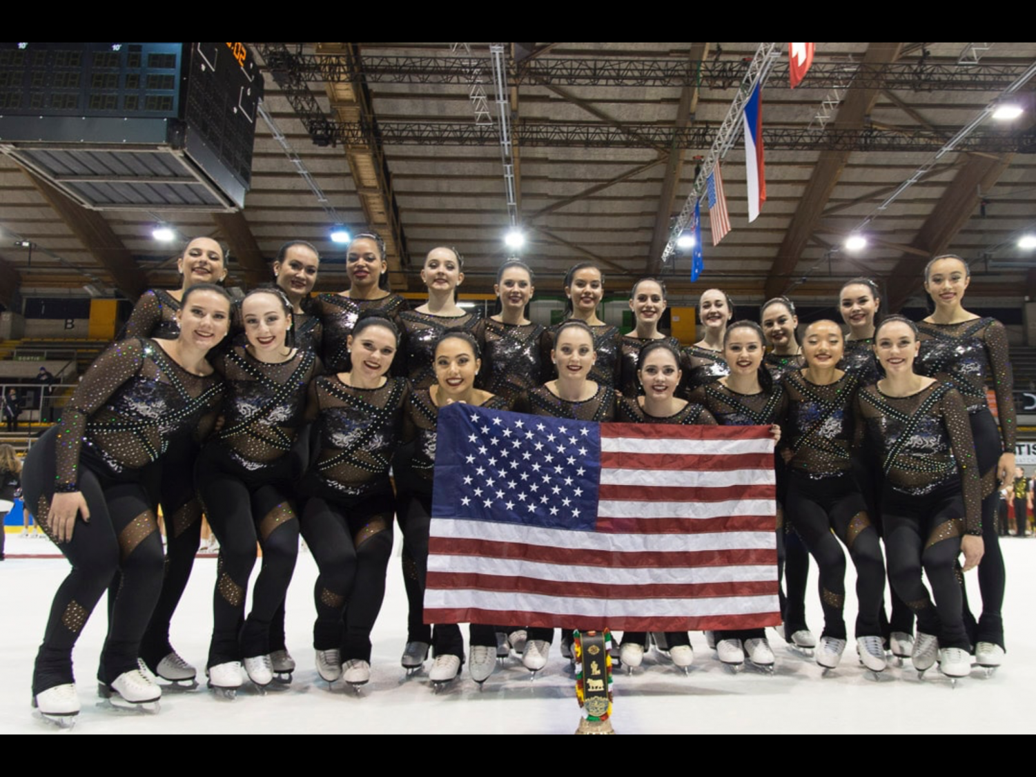 Corinne Fereshetian smiles with Team USA after a successful skate. (Photo reprinted with permission of Corinne Fereshetian.)