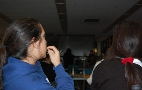 Juniors Frannie Lauck (left) and Jenny Jaramillo (right), members of SHH, gather in the Media Center to view the film Coco at the first fiesta of the school year. Photo by Carrie Jefferson