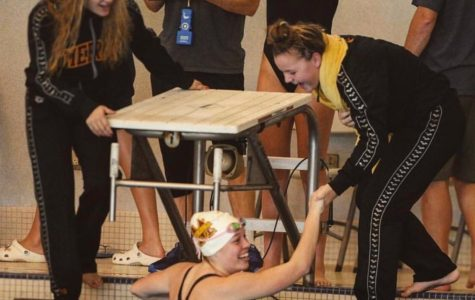 Swim team's winning streak continues