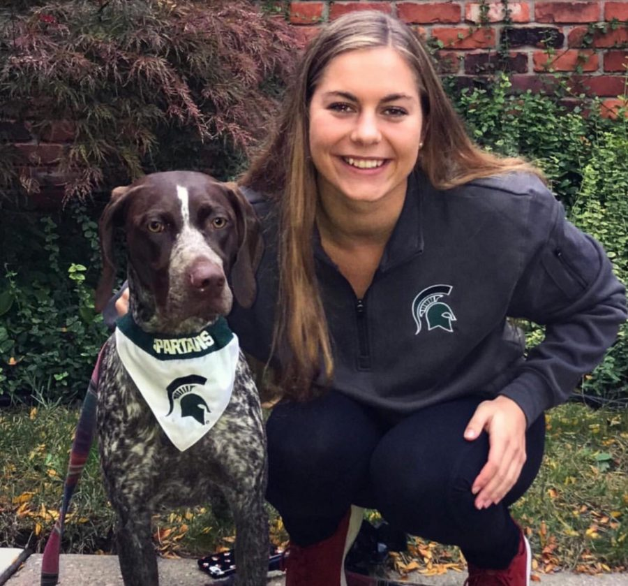 Dombkowski smiles with her dog in MSU gear, showing her excitement to start this new journey. Photo used with permission from Annette Dombkowski