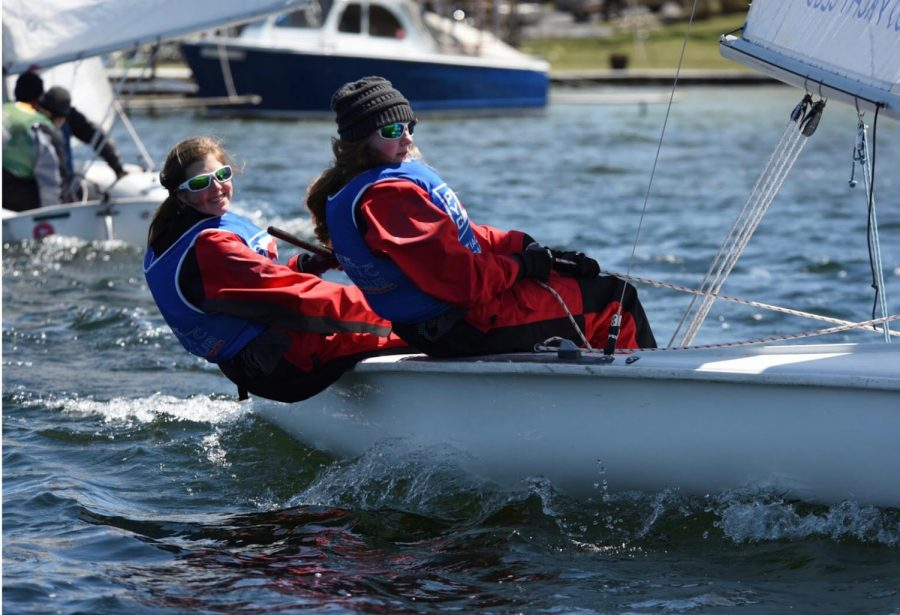 uniors Anna Sauer and Jenna Kozal bundle up as they compete in a sailing competition.  Photo used with permission from Anna Sauer