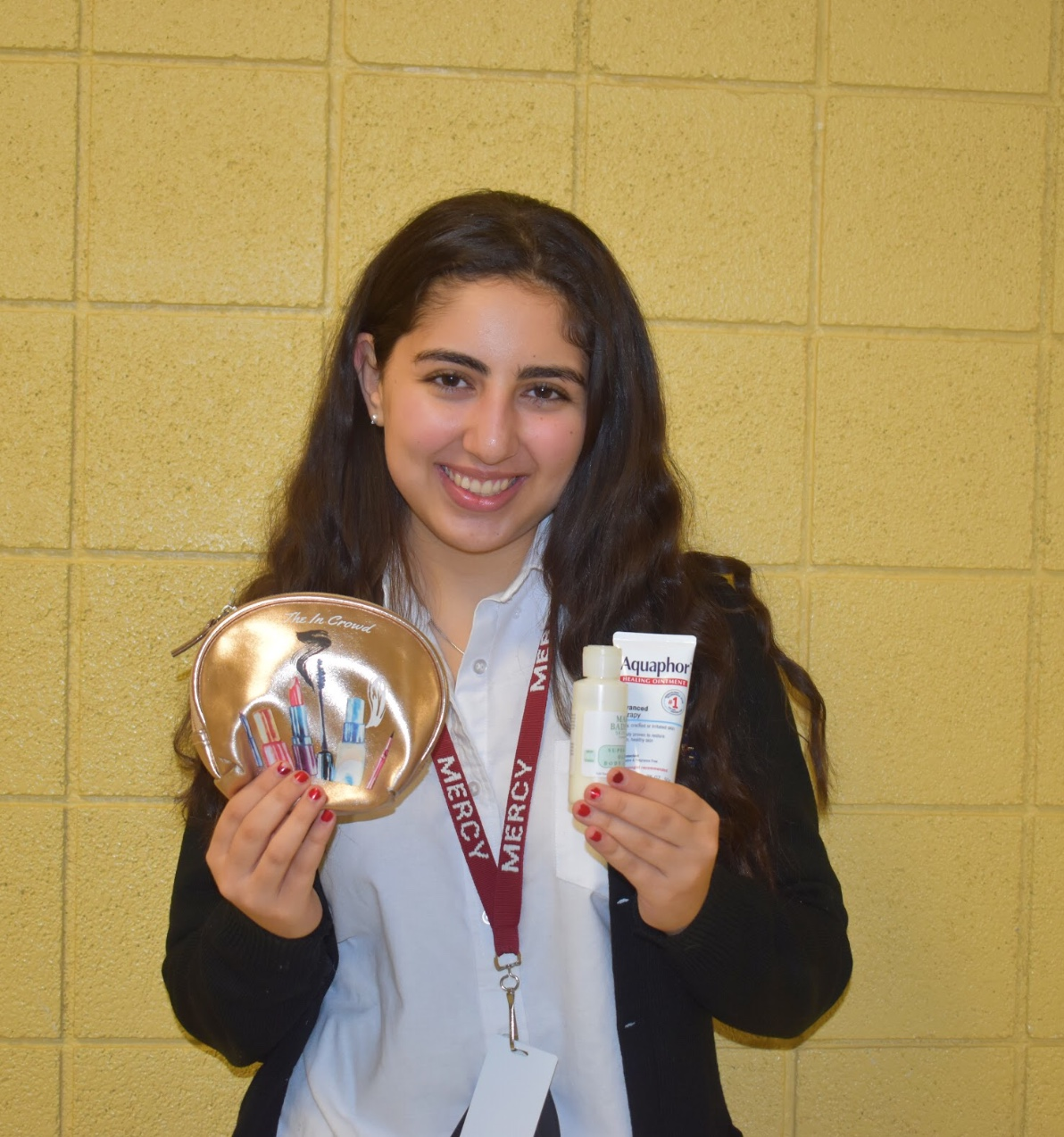 Senior Nicole Hesano carries a emergency kit in her backpack with products to help her skin cope with the cold weather. Photo by: Sabrina Yono