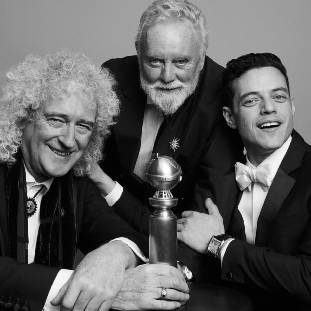 Official picture taken from the Golden Globes of Queen members Brian May (left) and Roger Taylor (middle) with the star of Bohemian Rhapsody Rami Malek (right) celebrating the film's win.  Fair use: Instagram