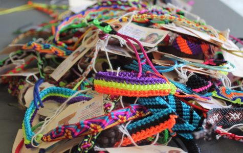 Spanish Honors Society's Pulsera Project fundraiser offered hundreds of bracelets for students to purchase for only $5. The proceeds went towards improving Central American communities and supporting pulsera artists. Photo by Colleen Thomson