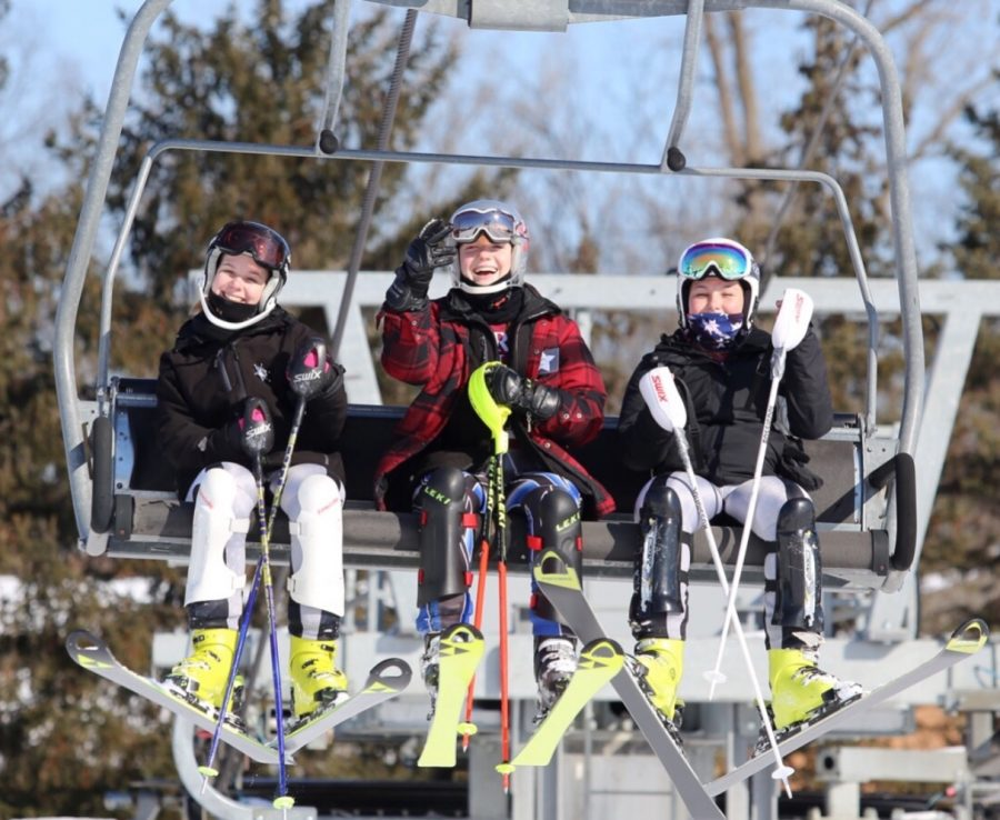 Junior Julia Crowley (middle) and her fellow teammates sophomore Katie Ruffing (right) and junior Peyton Black (left) riding on the ski lift to get to the top of the hill at practice.  Photo used with permission from John Brady