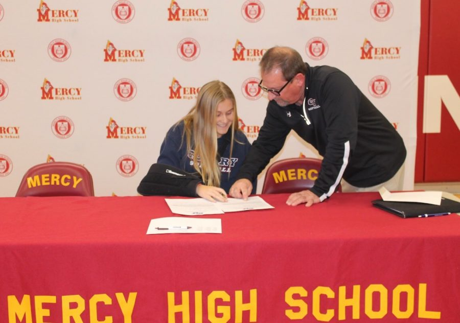 Senior Sarah Cassidy signs a contract with Cleary University December 14 2018, commiting her acceptance to the school and its softball program. Photo used with permission from Sarah Cassidy