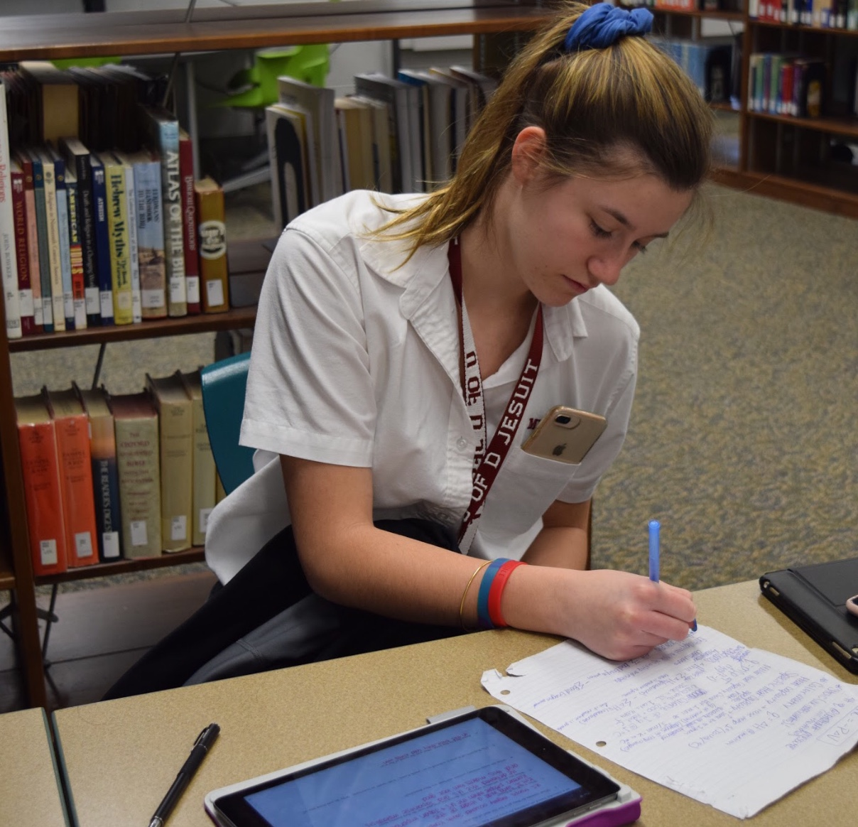 Junior Kayla Shields works hard on her schoolwork while preparing for her final exams that will be approaching at the end of May, hoping to keep her A's in her classes.  Photo by Bella Aprilliano
