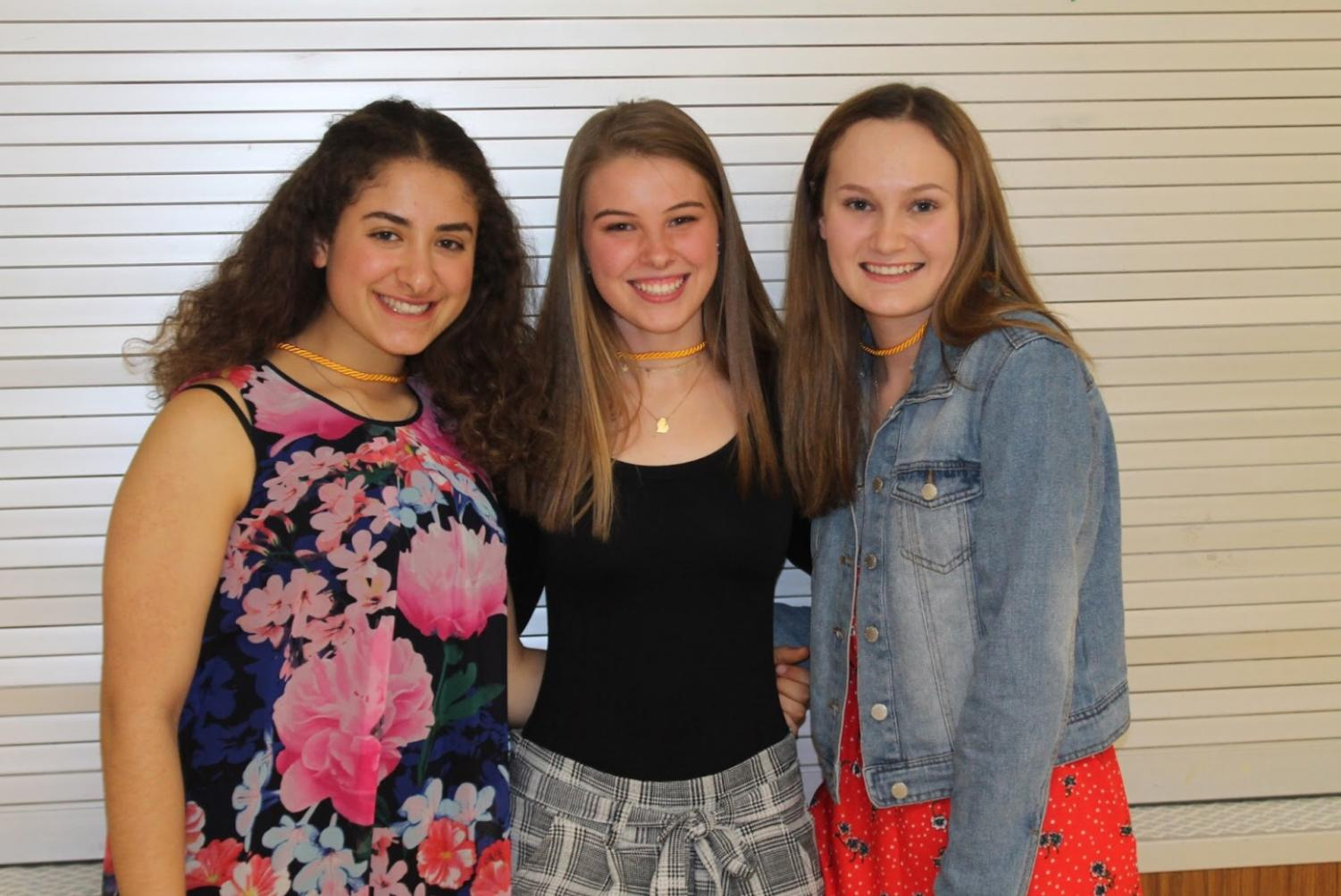 Juniors Suha Qashou (left), Paige Skorupski (middle), and Nicole Yaekle (right) acknowledge their success over their three years at Mercy after being inducted into the National Honor Society.  Photo by Bella Aprilliano