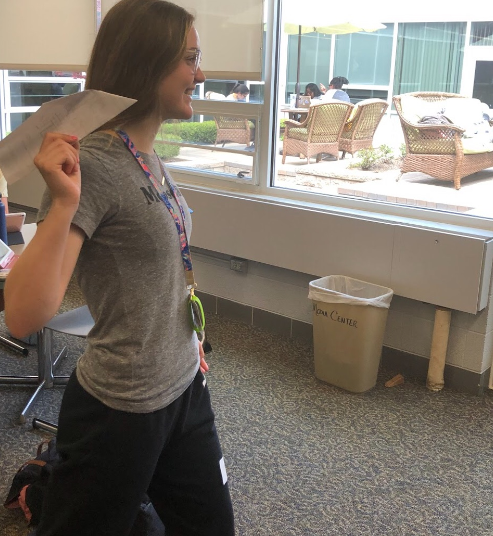 Mercy junior and Science Club officer Macey Earle shows off her paper airplane making skills to go along with the Science Club's theme of flight. Photo by Carrie Jefferson