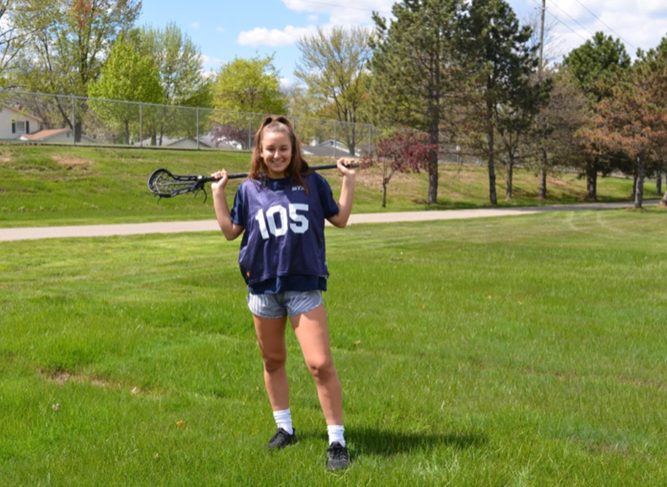 Sophomore Jill Smith poses with her lacrosse stick before jumping into a rigorous practice.  Photo by Alyssa Johnston