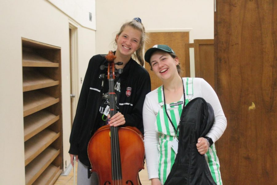 Senior orchestra members Emily Susitko (left) and Sophie Vanderweele (right) enjoy their time before they take the stage for rehearsal.  Photo by Abbey Roegner