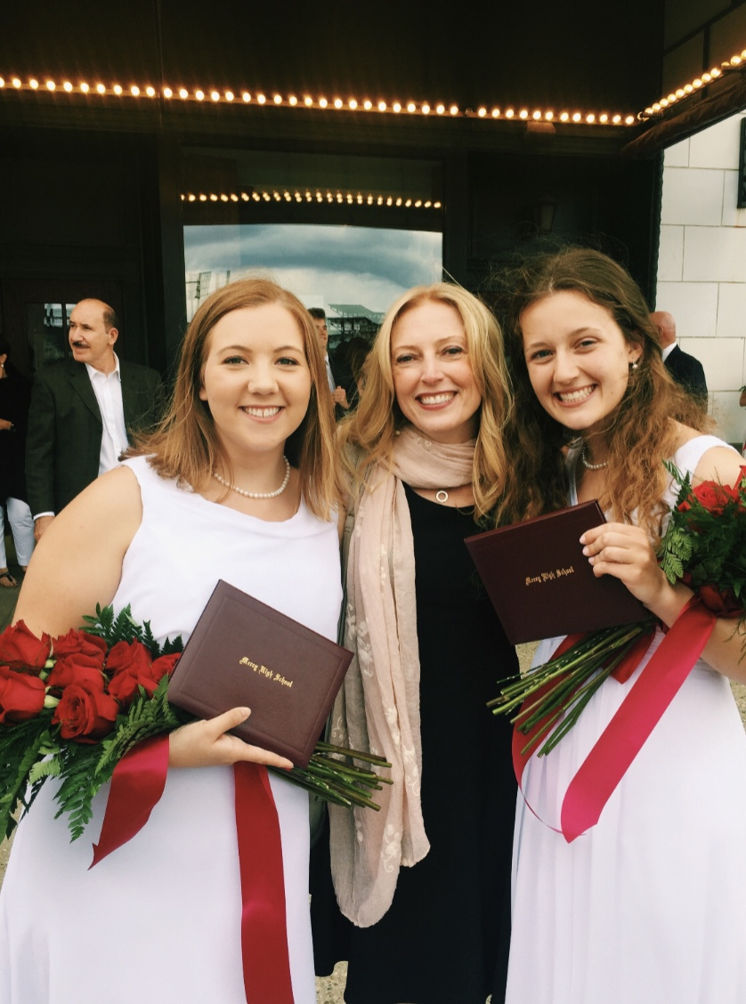 Teacher of the Year Ms. Lisa Wilson smiles with former A.P. Biology students Abbey Roegner (left) and Katie Bullock (right) one final time after the 2019 graduation ceremony. Photo used with permission from Diane Roegner