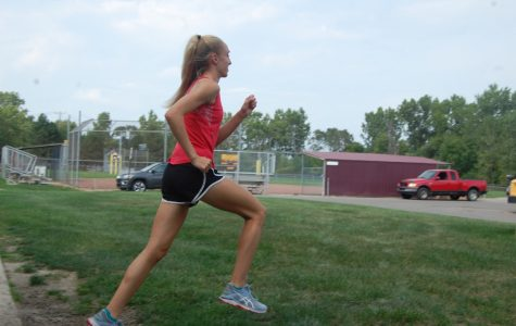 Mackenzie Sullivan strides at practice, working on improving her form and posture to help her in upcoming meets. Photo by Delilah Coe