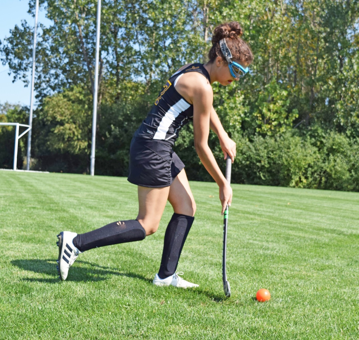 Sophomore Julia Rea shoots the ball for a goal mid-practice. Photo by Rachael Salah