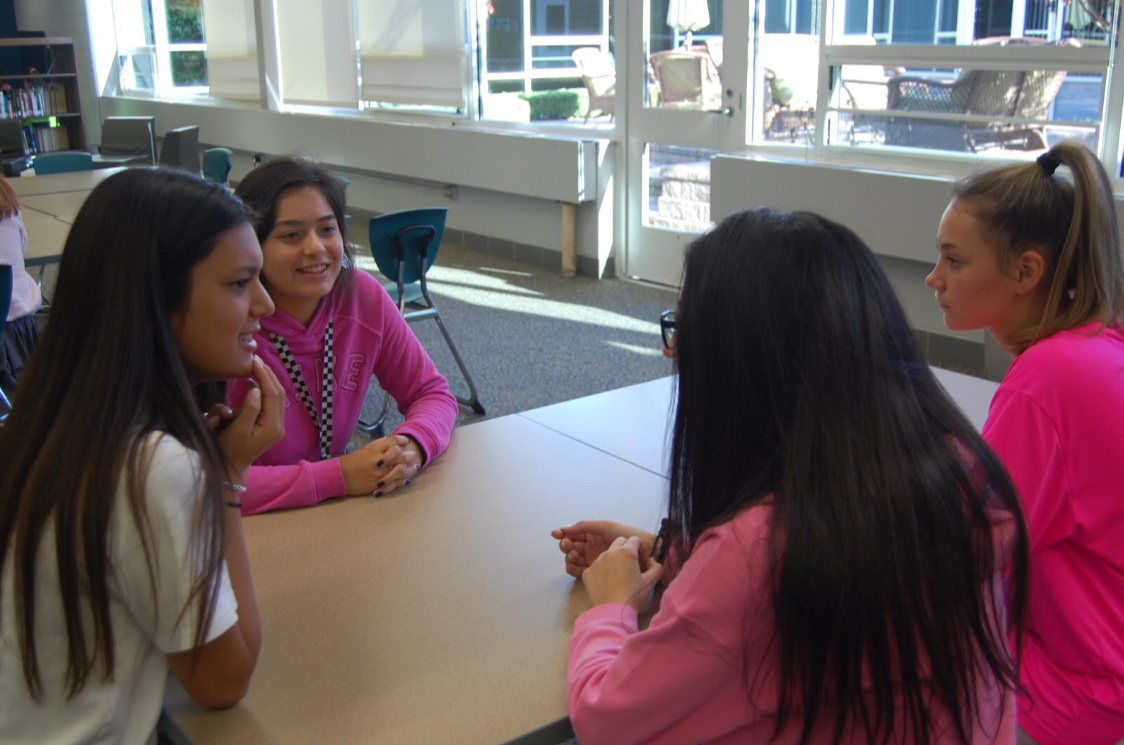 Green Club leaders discussing plans for their next meeting. Photo by Emily Walugembe