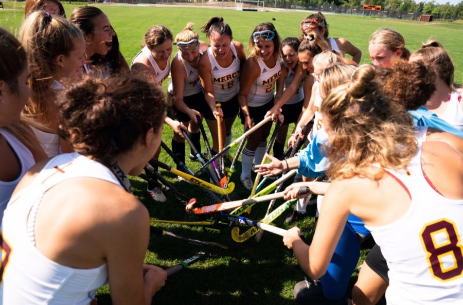 Mercy's field hockey team huddles up to get each other excited for their game. Photo used with permission from Grace Fadool