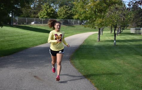 Gabby Pluszczynski runs around the Mercy fields during a cross country practice. Photo by Isabelle Sawicki