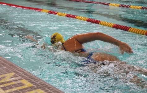 Julia Coffman swimming at practice during warm-ups. Photo by Rachael Salah