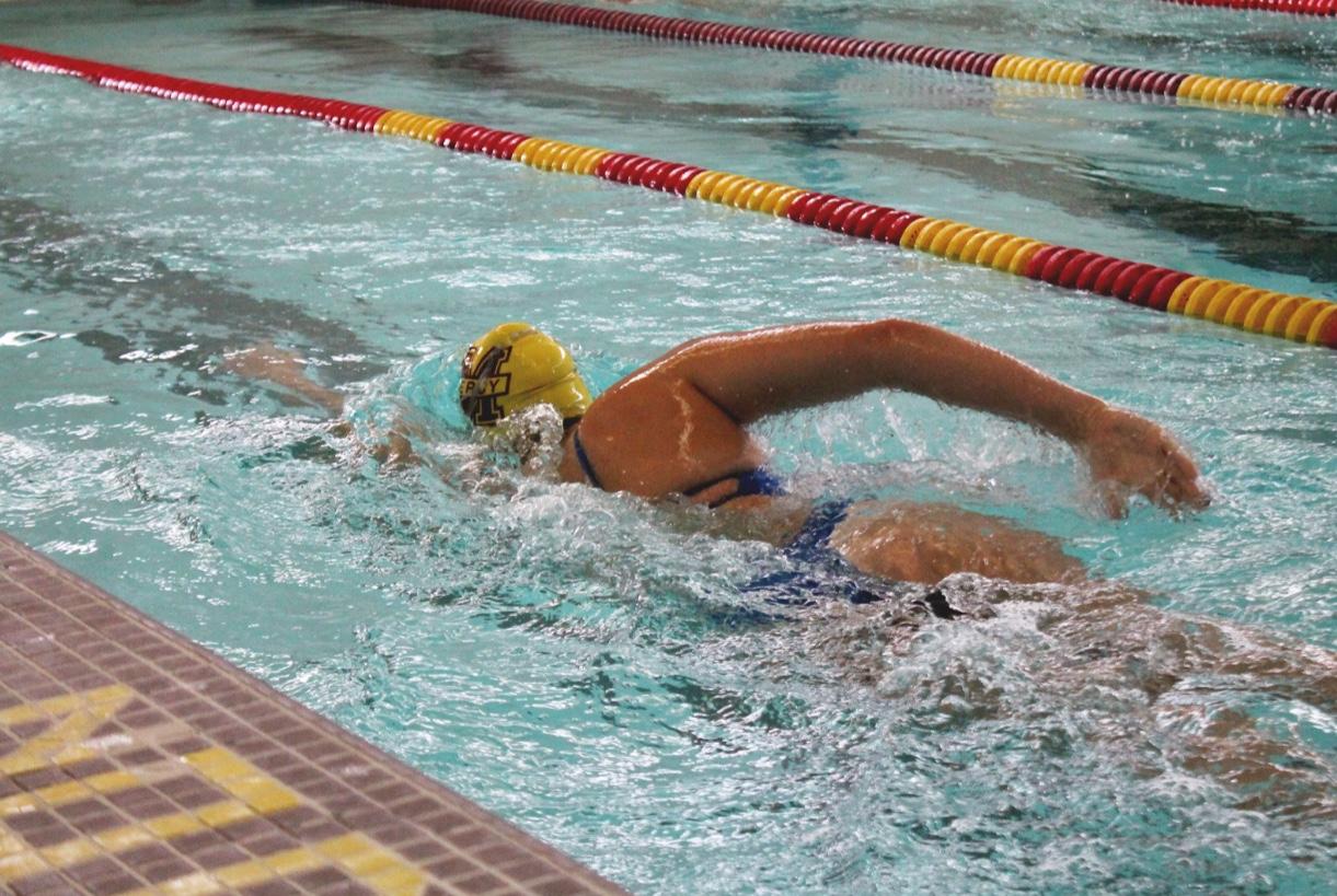 Julia Coffman swimming at practice during warm-ups. Photo by Rachael Salah