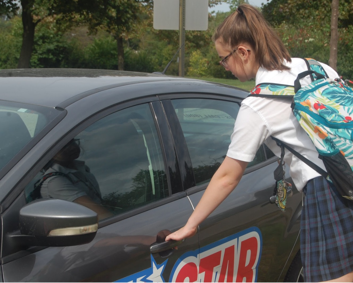 Sophomore Renee Predhomme gets into the All Star car to drive with her instructor for segment one. Photo by Emily Walugembe