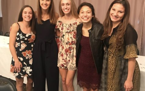 The cross country team at their banquet, which marks the end of the season. Left to right: freshman Reagan Sullivan, junior Megan Mallie, junior Mackenzie Sullivan, junior Katie Kim, and senior Gabby Pluszczynski. Photo used with permission from Katie Kim