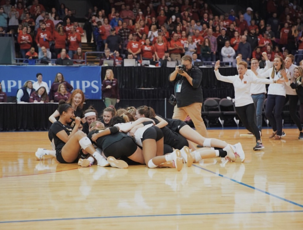 MVV celebrates their first state championship win as their coach runs on the court to congratulate them. Fair use: Instagram
