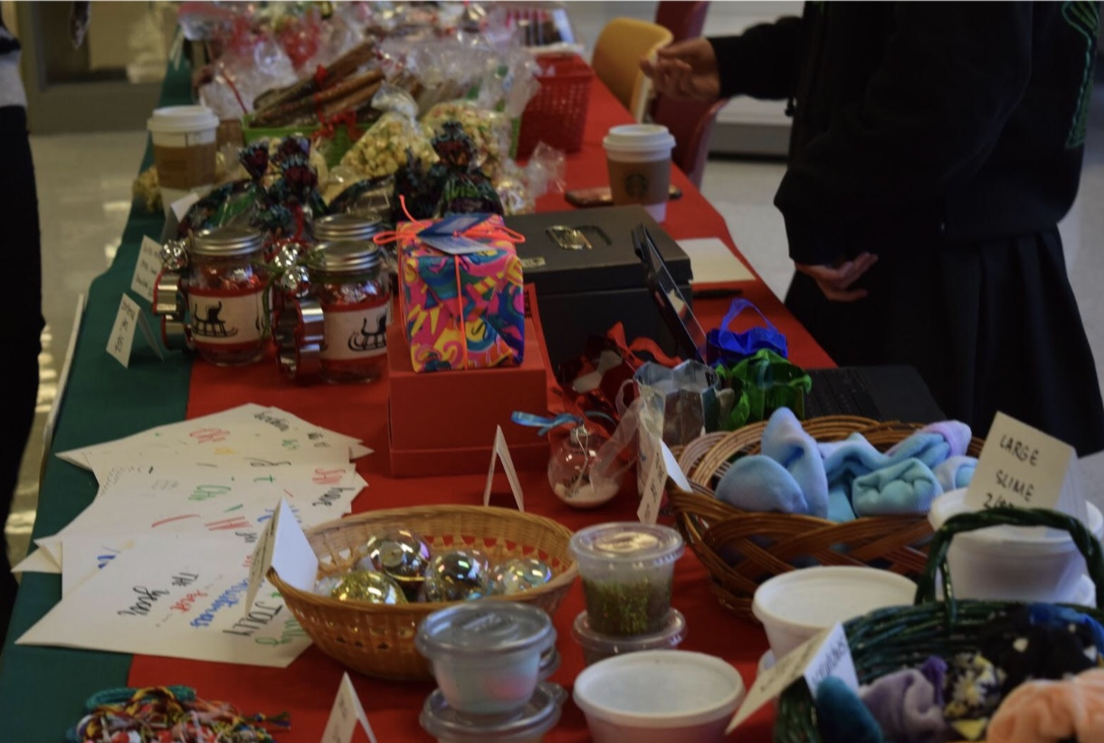 The Salmagundi table displays a wide variety of items for purchase including slime, handmade Christmas cards, and ornaments. Photo by Maddie Sullivan