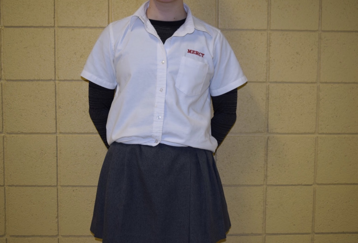 Senior Sarah Puscas wears the black long sleeve shirt under her uniform blouse during the first few weeks this new policy has been in effect. Photo by Megan Mallie