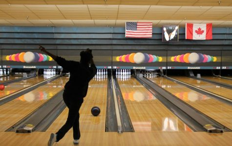 Junior LaNiya Brantley bowls at the Bowling One Lanes for the team's sixth meet. Photo by Emily Walugembe