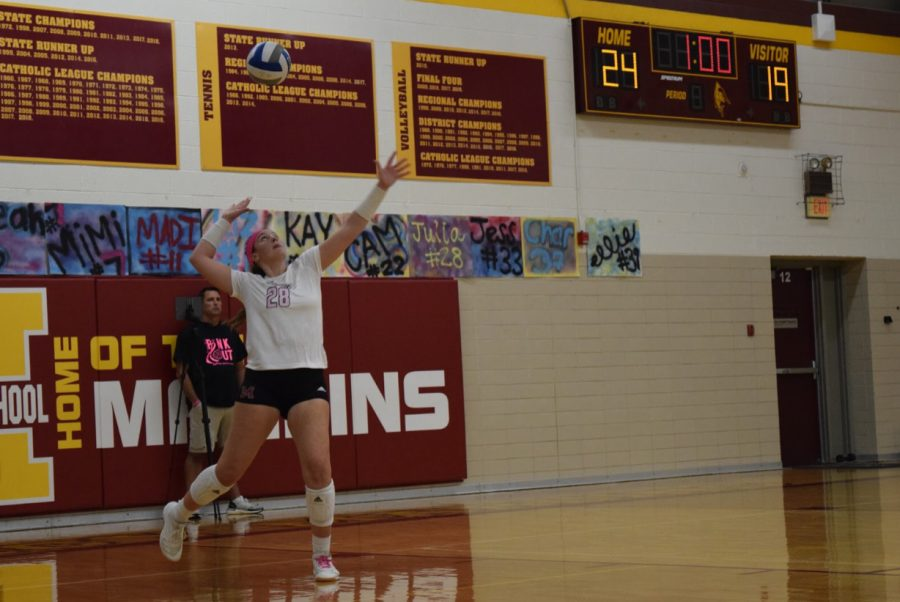 Junior Julia Bishop launches a powerful serve to the opposing team at the pink out game earlier in the year. Photo by Dunya Kizy